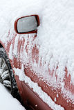 Red car in winter covered with snow Stock Photo