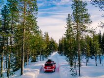 Free Red Car With Roof Rack Driving On Snow Forest Road In Winter Royalty Free Stock Photo - 170483535