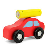 Red car with yellow battery on top of roof Royalty Free Stock Photo