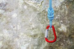 Free Red Carabiner With Climbing Rope On Rocky Background Stock Photos - 84350493