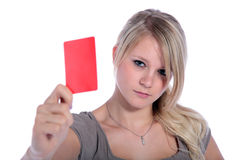 Red card. An attractive young woman showing someone a red card. All on white background Royalty Free Stock Photography