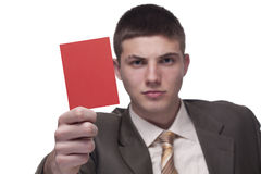 Red card. Young businessman showing a red card Royalty Free Stock Photography