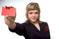 RED CARD. A girl is giving a business card Royalty Free Stock Photography