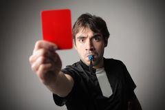 Red card. Angry referee whistling an showing a red card Stock Photos