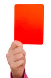 Red card. Female hand is showing a red card Royalty Free Stock Photo