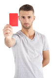 Red Card. A handsome man shows someone a red card. All isolated on white background Stock Image