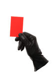 Red card with black leather gloves Royalty Free Stock Photo