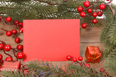 Red card with Christmas Decorations Royalty Free Stock Photography