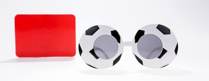 Red card and football sport spectacles isolated on white. Background Royalty Free Stock Photo