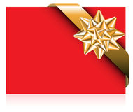 Red card with golden bow. Golden ribbon with bow on the red paper card Royalty Free Stock Photo