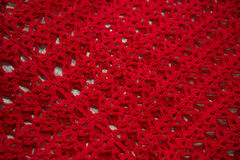 Red cardigan knitted in manual photographed in close-up. Stock Photography