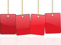Red cards hanging from chains Royalty Free Stock Photography