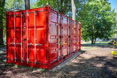 Red cargo container. Located in a park royalty free stock photos