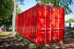 Red cargo container. Located in a park stock photos