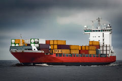 Red cargo container ship Stock Photos