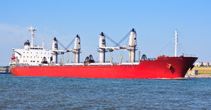 Red cargo ship. In the sea Royalty Free Stock Photo