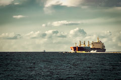 Red cargo ship Stock Images