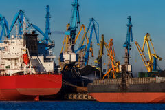 Red cargo ship. Loading in the port of Riga, Europe royalty free stock photography