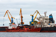 Red cargo ship. Loading in the port of Riga, Europe stock photos