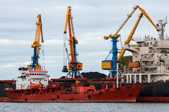 Red cargo ship. Loading in the port of Riga, Europe stock image