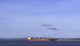 Red cargo ship at port Royalty Free Stock Images