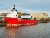 Red cargo ship in a port Stock Images