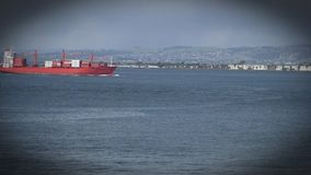 Red cargo ship in the waters of San Francisco Bay. San Francisco Bay with red cargo container ship cruising on the water stock video