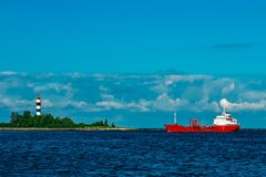 Red tanker ship. Red cargo tanker ship moving by the river Stock Images