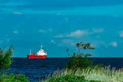 Red tanker ship. Red cargo tanker ship moving by the river Royalty Free Stock Photos