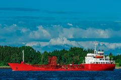 Red tanker ship. Red cargo tanker ship moving by the river Royalty Free Stock Photography