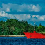 Red tanker ship. Red cargo tanker ship moving by the river Stock Photos