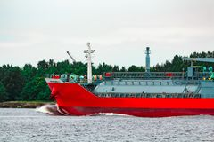 Red cargo tanker ship. Red tanker. Toxic substances and petroleum products transfer Stock Photos