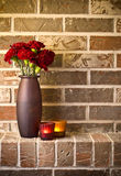 Red carnations against brick wall