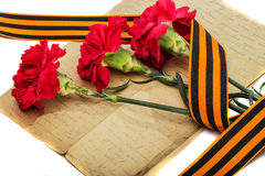 Red carnations and St. George's Ribbon Stock Images
