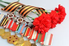 Red carnations tied with Saint George ribbon and medals with ord Royalty Free Stock Image