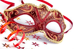 Red carnival mask with confetti and streamer Stock Photo