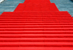 Red carpet. On marble stairway welcoming VIPs Stock Image