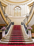 Red carpet. Stairwell in the Polish palace. An old architecture Royalty Free Stock Photo
