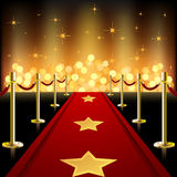 Red Carpet. Covered wuth stars in front of defocused light Royalty Free Stock Photos