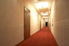 Red carpet. Corridor with a red carpet in hotel Royalty Free Stock Photo