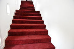 Red carpet. Stairs covered with red carpet Stock Images