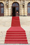 On a red carpet. Red carpet to the theater Stock Image