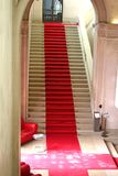 Red carpet. On clasically designed marble staircase Royalty Free Stock Photography
