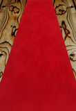 Red carpet. Red velvet carpet fabric over a wooden floor Royalty Free Stock Photography