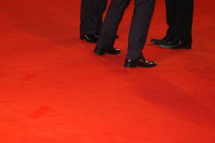 Red carpet. Black man shoes on a red carpet Stock Image
