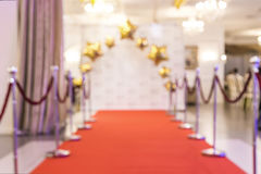 Red carpet background. Red carpet with the sides, blurred background Royalty Free Stock Photography