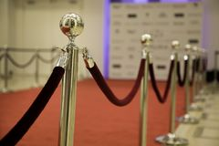Red carpet with barriers. And velvet ropes stock images