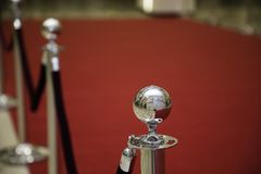 Red carpet with barriers. And velvet ropes stock photo
