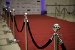 Red carpet with barriers. And velvet ropes royalty free stock images