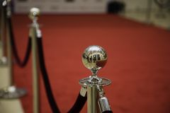 Red carpet with barriers. And velvet ropes royalty free stock photo